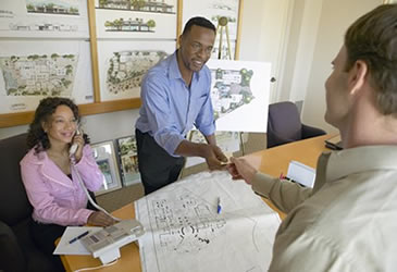 Photo of a man and woman doing business with a customer.